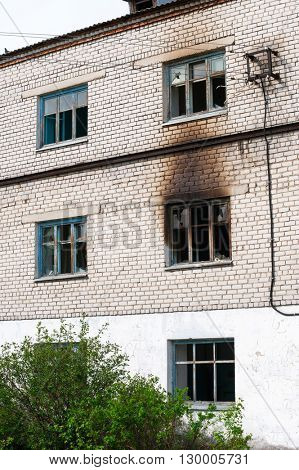 Facade of highrise house after an explosion and fire poster
