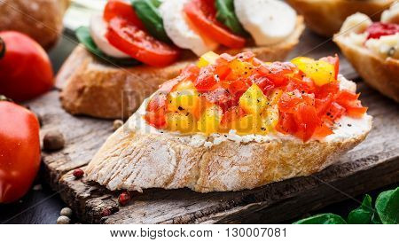 Italian bruschetta with chopped tomatoes, herbs and oil on toasted crusty ciabatta bread