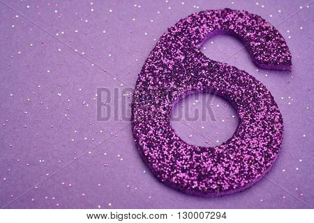 Number six purple color over a purple background. Anniversary. Horizontal