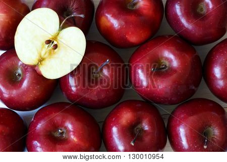 Background of red delicious ripe apples - healthy eating concept