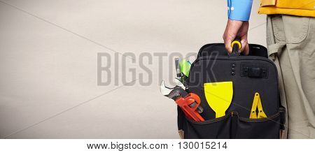 Hand of handyman with a tool bag.