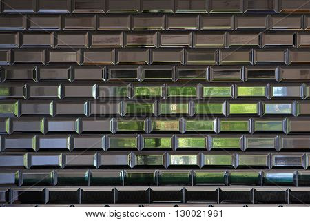 Ceramic tile wall reflections of window light.