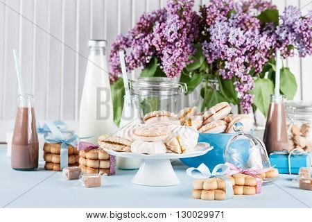 Cookies milkshakes jar of candies flower and gifts in blue and pink with lilac flowers