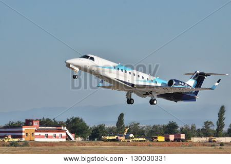 Simferopol Ukraine - September 12 2010: Embraer EMB-135BJ business jet is taking off from the airport in the evening