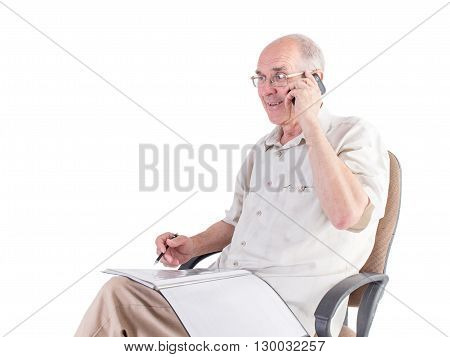 Old smiling man with folder and pen talking on the phone. Isolated on a white background.