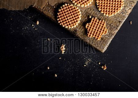 Waffles on baking paper on old wood