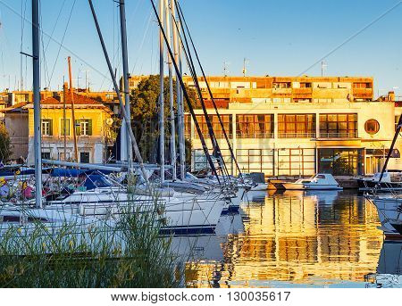 Sailboats in Zadar harbor at the sunset Croatia.
