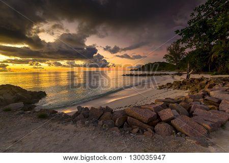 Beautiful view of Anse Kerlan beach at the sunset, Praslin, Seychelles