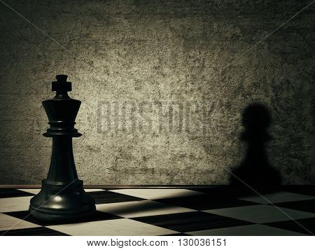 King chess piece casting a shadow of a pawn on a concrete wall. Complex and mismanagement concept. Magical transformation