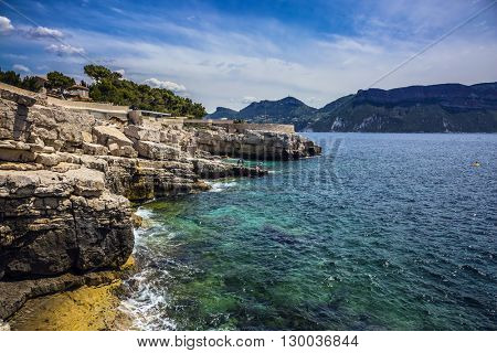 Abrupt stony coast and turquoise sea surface. Famous National Park Calanques on the Mediterranean coast