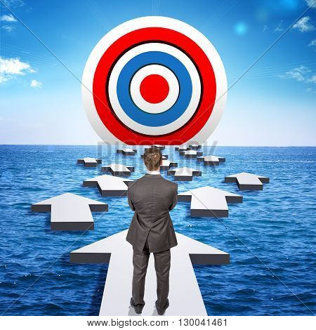 Businessman goes through obstacles to goal. Man in suit standing on arrow. Ahead of target