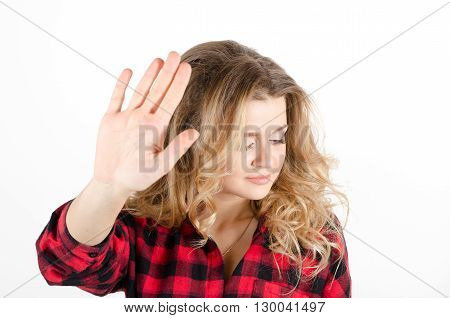 Young Woman Showing Sign No Or Stop With Her Hand