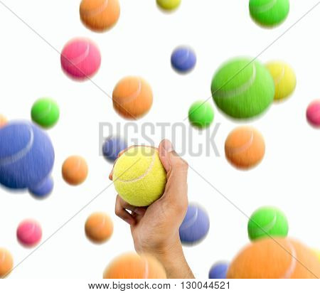 man catching the ball right in a shower of tennis balls