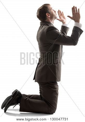Isolated business man pray position on white background