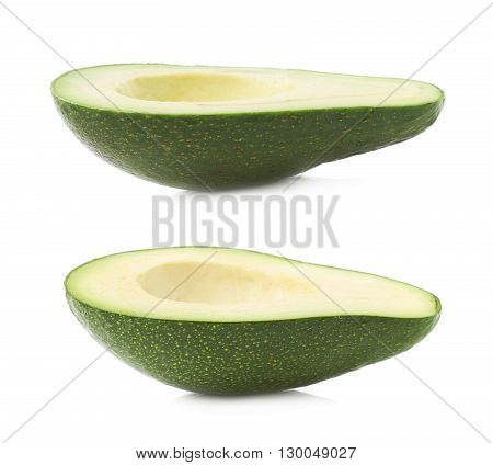 Half of ripe avacado fruit without the pit, composition isolated over the white background, set of two different foreshortenings