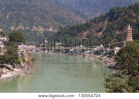 RISHIKESH INDIA - OCTOBER 20 2014 : Holy Ganges river that flows through Rishikesh (the world capital of Yoga) - the holy city for the Hindus India.