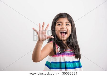 indian small girl counting five, asian small girl showing 5 fingers or five numbers with fingers