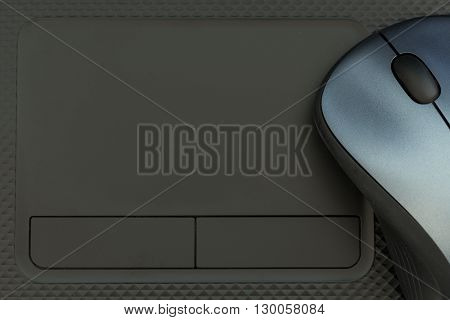 Laptop can control by both mouse and touchpad. Empty space of the touchpad in this picture can fill any word in it.