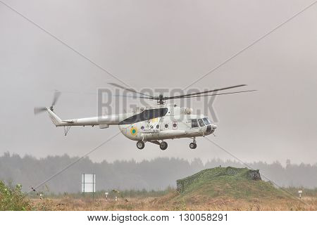 Zhitomir Ukraine - September 29 2010: Ukrainian Army military transport helicopter is landing under the rain during the military trainings