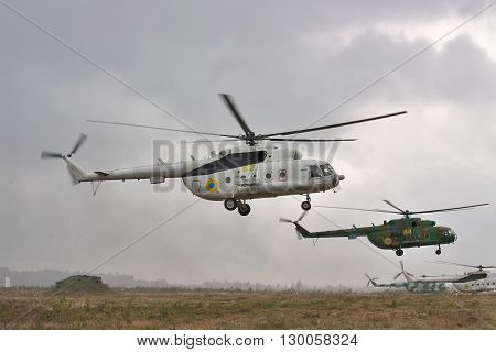 Zhitomir Ukraine - September 29 2010: Ukrainian Army military transport helicopters are landing under the rain during the military trainings