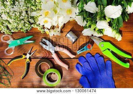 Garden Tools, Tools For Floristics And Flowers On A Wooden Table.