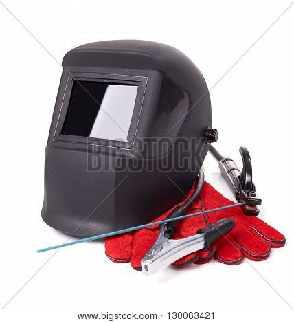Welding equipment isolated on a white background, welding mask, leather gloves, welding electrodes, high-voltage wires with clips, set of accessories for arc welding.