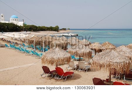 AGISTRI, GREECE - MAY 12, 2016: The sandy beach at Skala on the Greek island of Agistri. The 5.5km long Saronic island is under one hour from the Athens port of Piraeus.