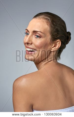Natural happy laughing portrait of beautiful middle age woman in studio