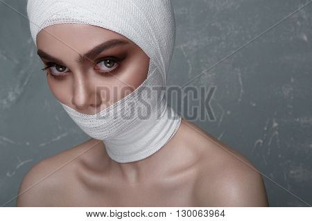 Beauty Woman with medical elastic Bandage on her Face