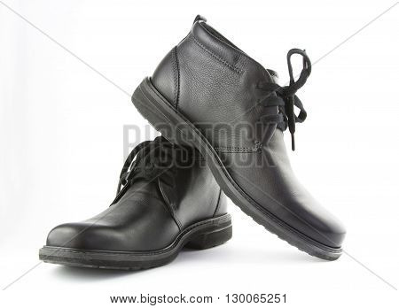Boots isolated. Black shoes isolated on white background