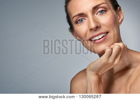 Attractive smiling middle age caucasian woman, isolated in studio