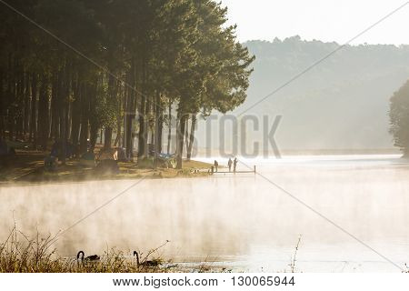 MAE HONG SON THAILAND - 03 FEBRUARY 2016 - Unidentified tourists wake up early to admire the mist and nature during sunrise at Pang Ung (Pang Tong reservoir) Thailand.