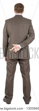 Businessman with his fingers crossed behind his back. Concept for good luck or dishonesty