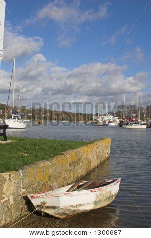 Old Boat Moored At Riverside