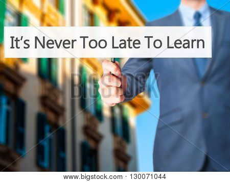 It's Never Too Late To Learn - Businessman Hand Holding Sign