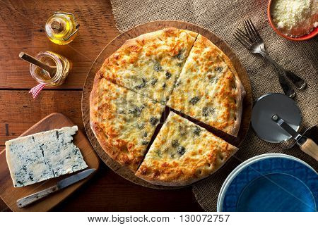 A delicous home made gourmet pizza with gorgonzola blue cheese.