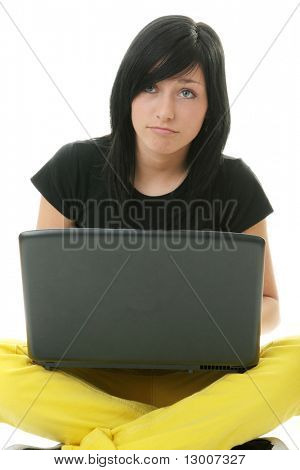 Girl working on her laptop, sending an e-mail or learning