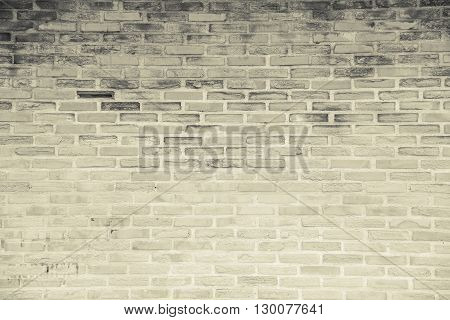 Beige-brown grunge brick wall texture or dirty surface pattern for background and backdrop architectural element in urban concept retro or vintage style