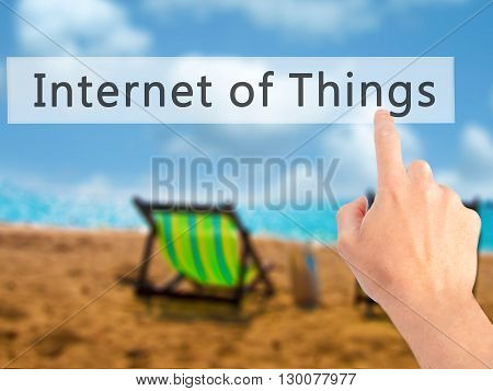 Internet Of Things  - Hand Pressing A Button On Blurred Background Concept On Visual Screen.