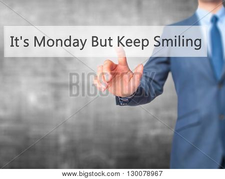 It's Monday But Keep Smiling  - Businessman Hand Pressing Button On Touch Screen Interface.
