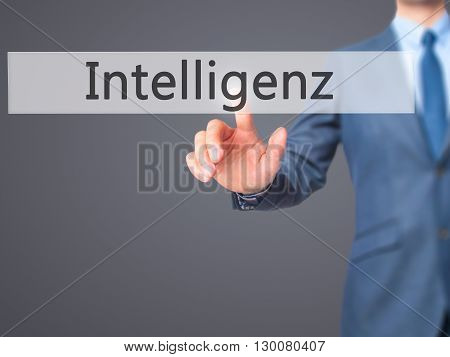 Intelligenz (intelligence In German)  - Businessman Hand Pressing Button On Touch Screen Interface.