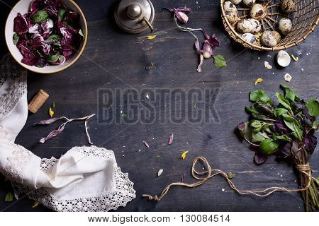 Raw organic salad greens with fresh ingredients for healthily cooking on wooden background, top view, banner. Vegan or diet food concept. Background layout with free text space.