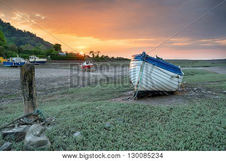 An Old Wooden Fishing Boat At Low Tide On Porlock Weir On The Exmoor Coast In Somerset