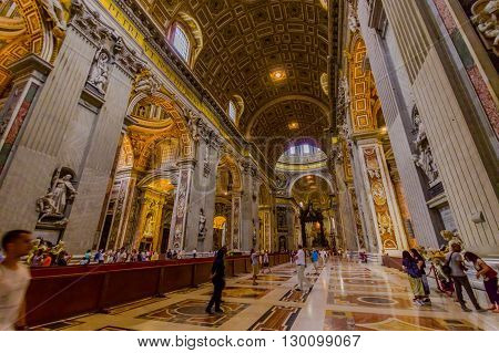 VATICAN, ITALY - JUNE 13, 2015: Saint Peter church in Vatican, main hall inside, turists walking around. The only one