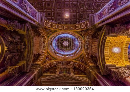 VATICAN, ITALY - JUNE 13, 2015: Roof nice view of Saint Peter Basilica at Vaticano city, the historic building that christians and all religions visit during all the year.