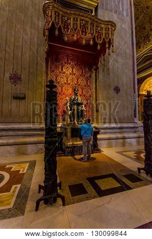 VATICAN, ITALY - JUNE 13, 2015: Apostle Saint Peter statue inside Saint Peter basilica on Vaticano, made of bronze. Turist