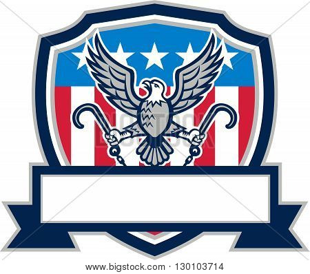Illustration of an american bald eagle looking to the side clutching towing j hook with its talon viewed from front set inside shield crest and banner ribbon in bottom with american stars and stripes flag in the background done in retro style.