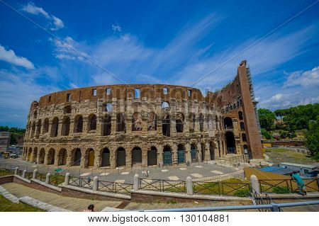 ROME, ITALY - JUNE 13, 2015: Roman Coliseum view in a nice summe day. Building works outside, historic great visit.