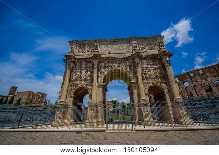 ROME, ITALY - JUNE 13, 2015: Constantine arch at Rome, this monument is located between the coliseum and palatine.