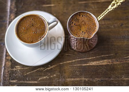 Turkish coffee and coffee pot on wooden background. Top View